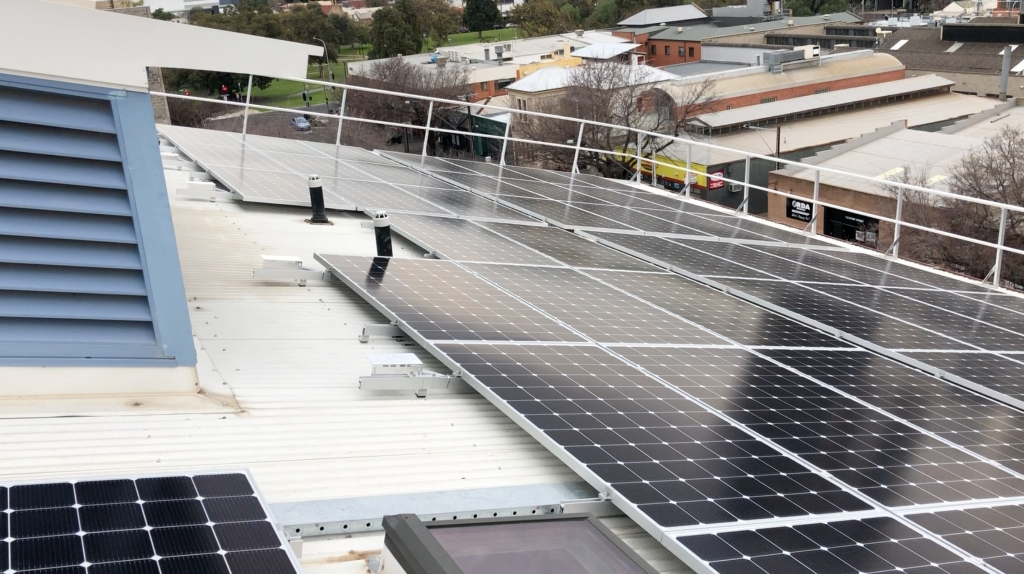 Completed installation of LG Solar 405W PVs on 4th level rooftop.